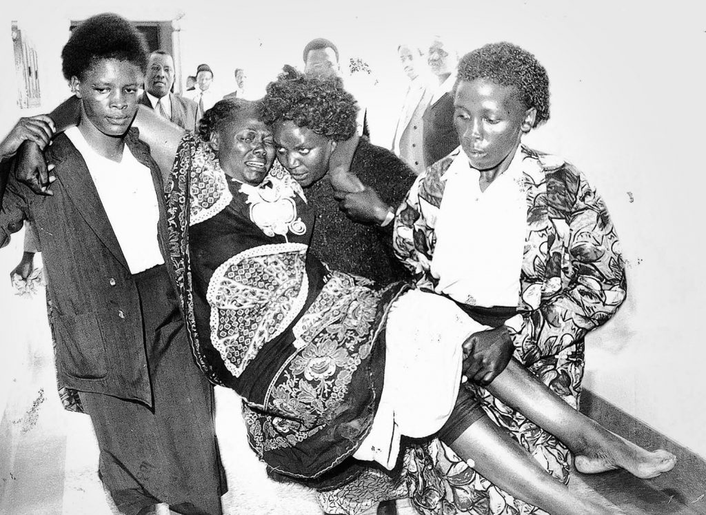 Picture dated January 1999 shows 2004 Nobel Peace Prize winner Wangari Maathai, environmentalist and human rights campaigner, carried to the courts after she was beaten by a mob after she confronted private developers that had illegally taken land in the Karura forest.