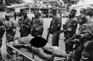 They then placed his body on a stretcher. If you look closely, you can see his right hand is missing most fingers, and one small toe appears to be missing.