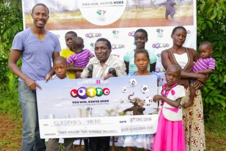 Cleophas and his family. Six? Seven children? Image from mylotto.co.ke